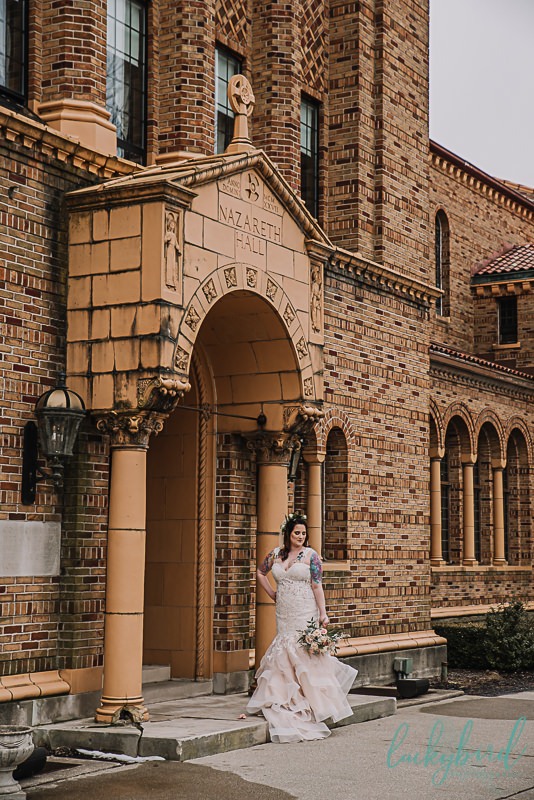 bride posing in front of nazareth hall