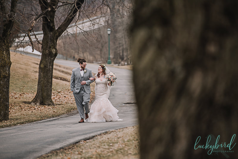 couple walking down the path at nazareth hall