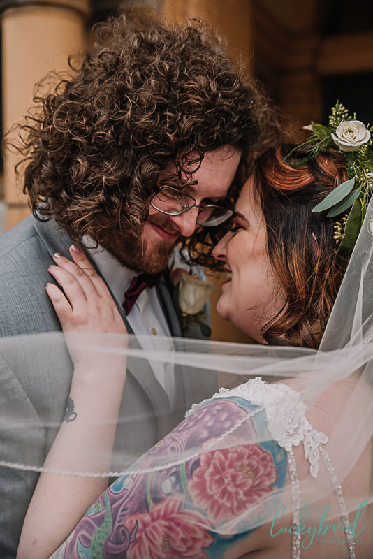 tattooed bride and groom with long hair at nazareth hall