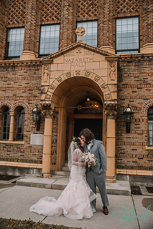 wedding kiss in front of nazareth hall