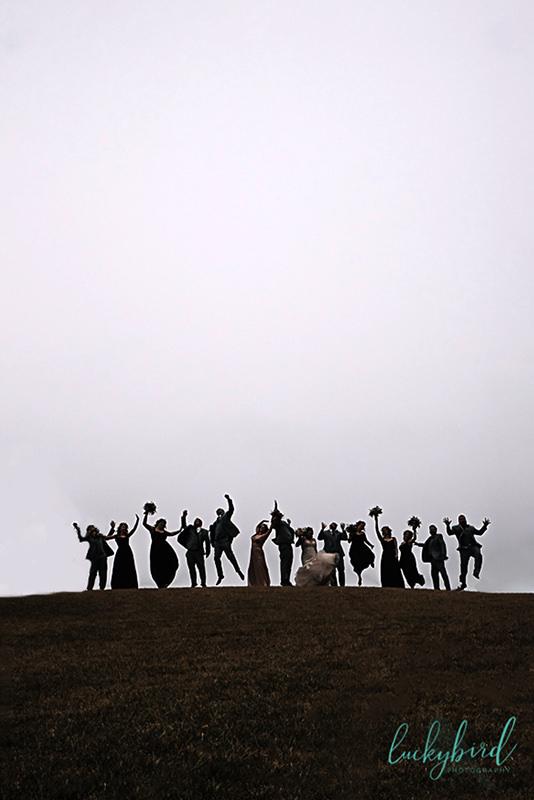 wedding party jumping at nazareth hall hill