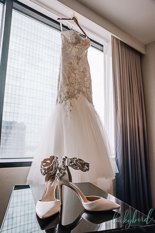 brides shoes and dress at renaissance toledo hotel