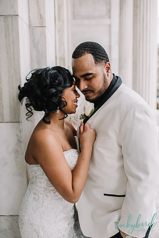 intimate bride and groom wedding photo at the toledo art museum