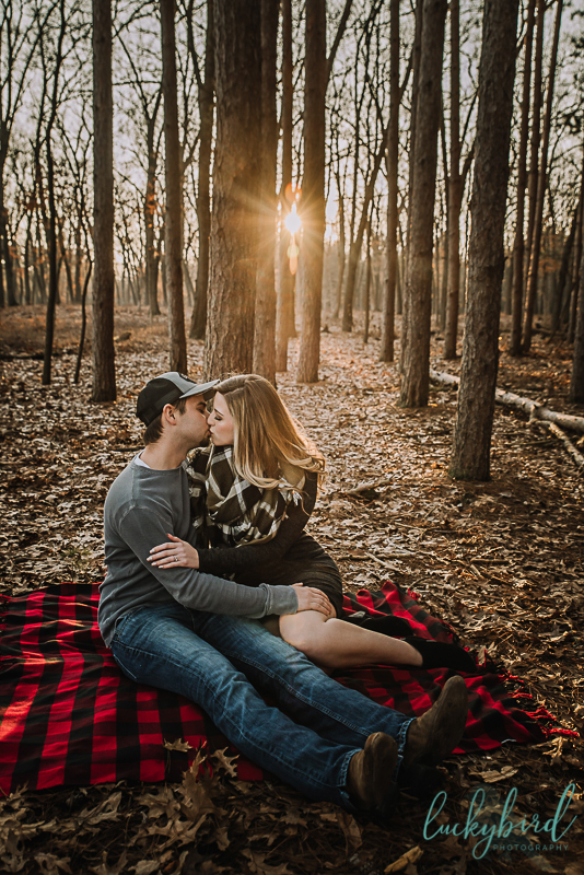 kissing engagement photo with blanket