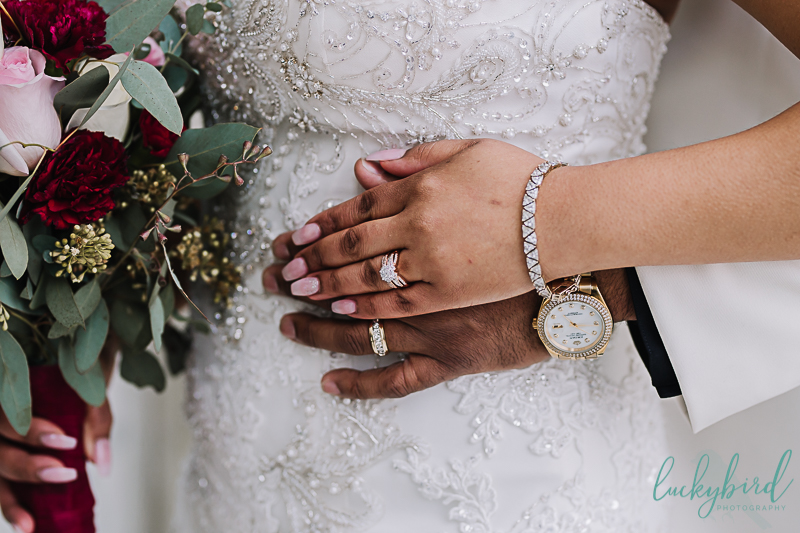 ring photo of bride and groom with bouquet