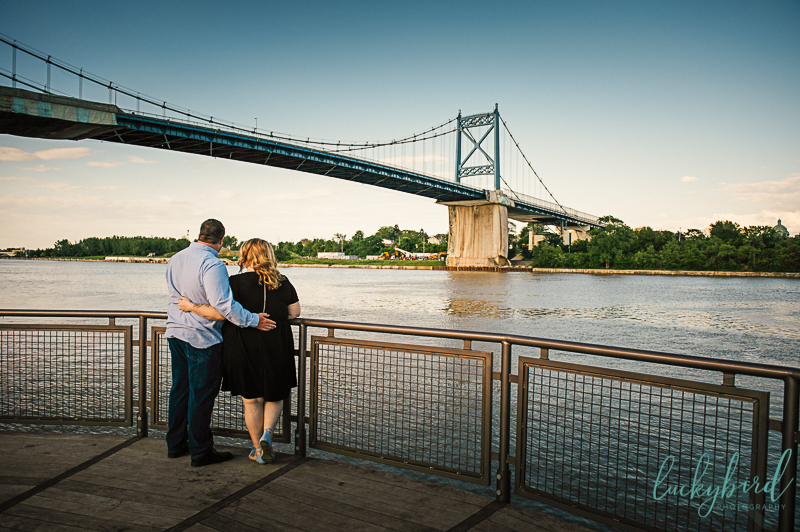 unique middle grounds park engagement photo with bridge