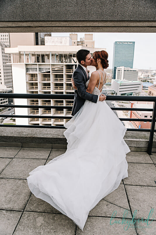 balcony wedding photo in downtown toledo