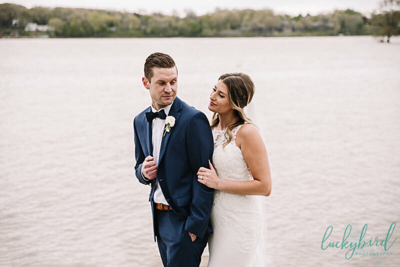 bride and groom by the water at toledo wedding