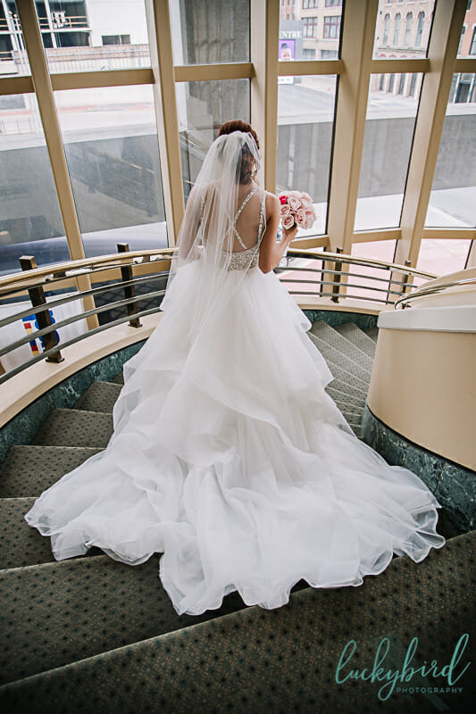 bride going down the stairs for park inn first look