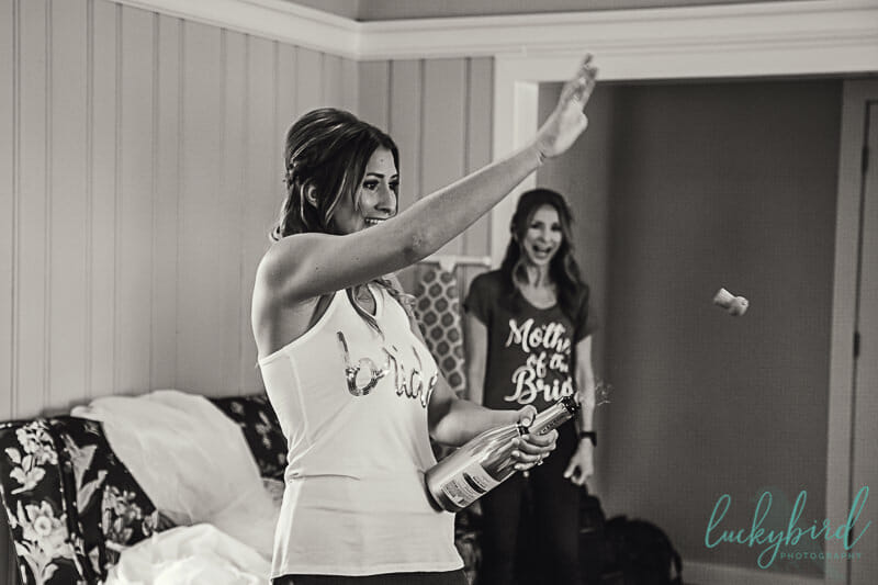 bride popping champagne at toledo country club