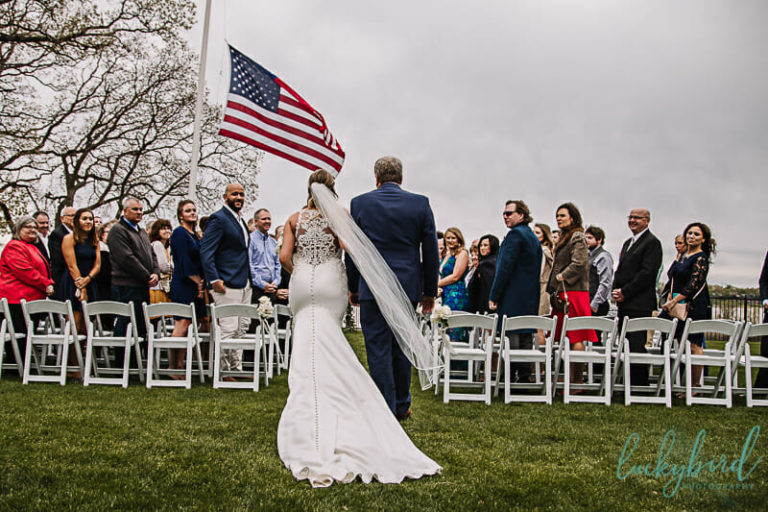 bride walking down the aisle at toledo country club outdoor wedding