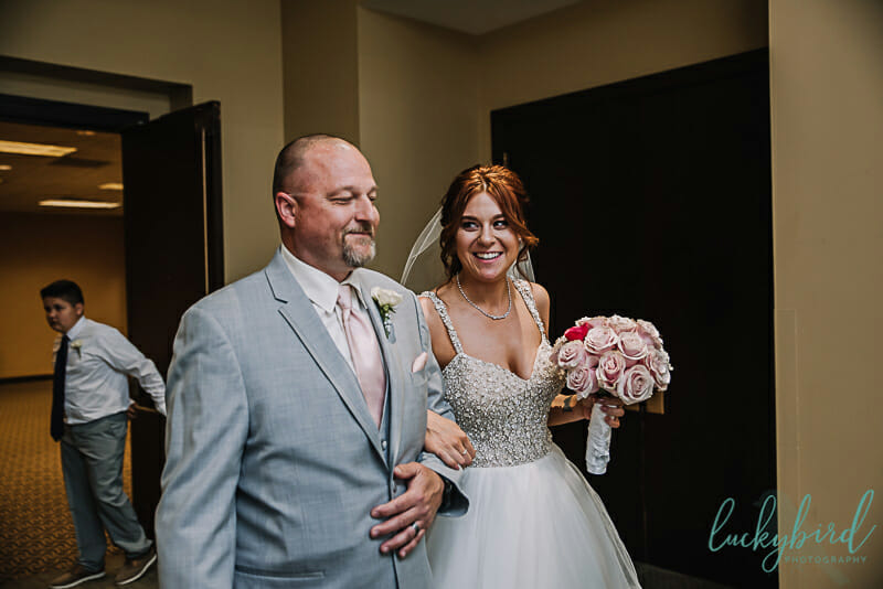father walking bride down the aisle park inn toledo ceremony
