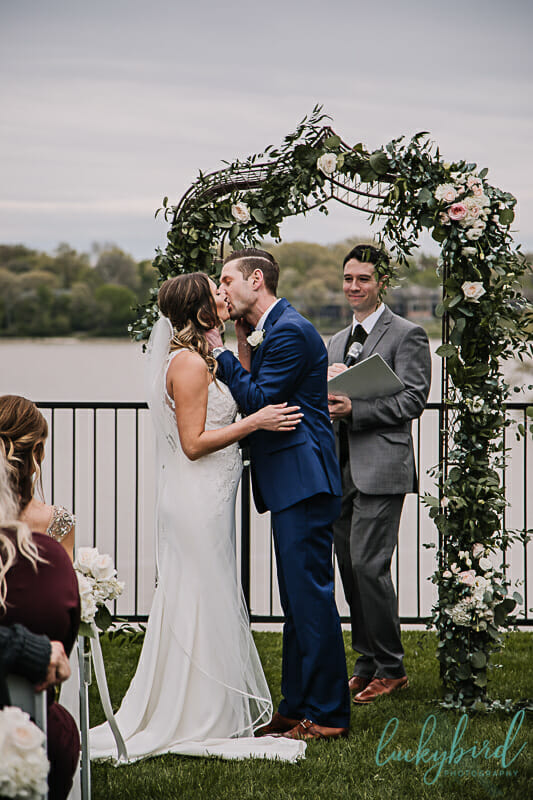 first kiss at outdoor toledo country club ceremony