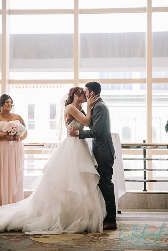 first kiss during park inn wedding ceremony