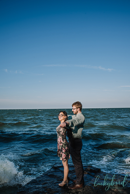 funny marblehead lighthouse engagement photo