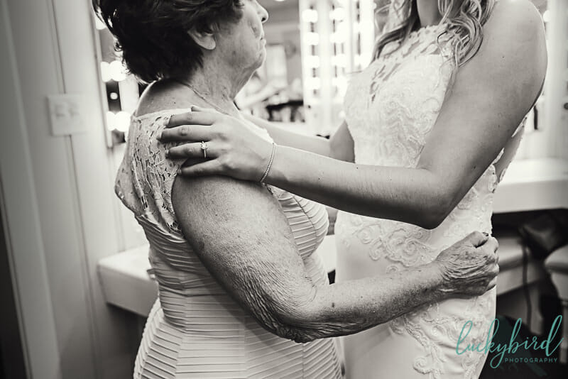 grandma hugging bride before wedding