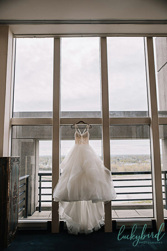 park inn wedding dress hanging in suite