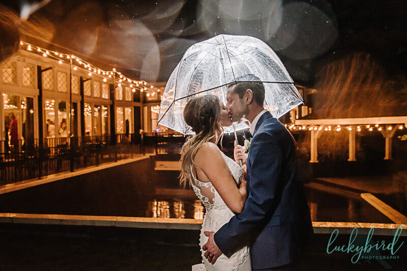 rain umbrella photography at toledo wedding