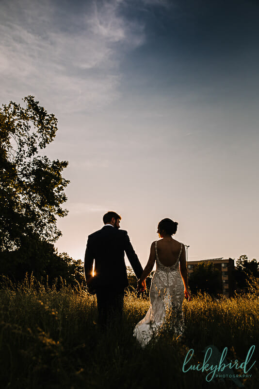 bride and groom sunset photo in downtown toledo ohio