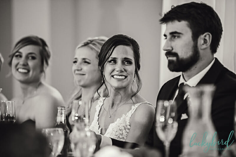 bride and groom toasts with tears in her eyes