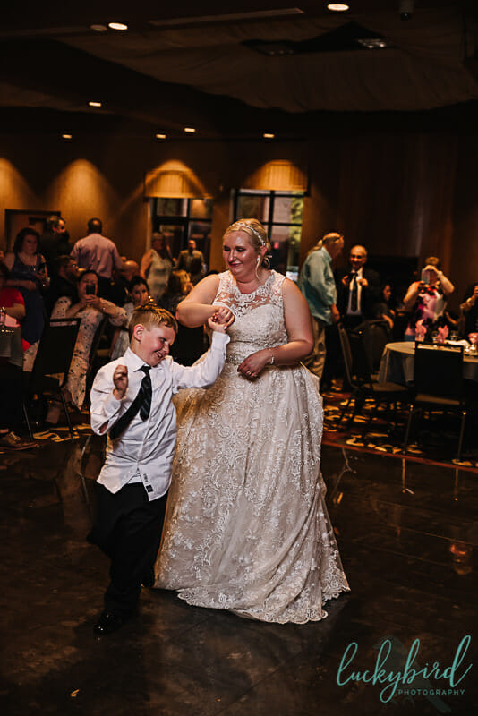 bride and son dancing at the pinnacle maumee