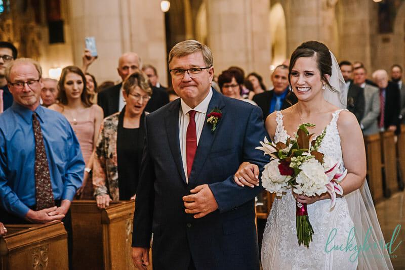 bride walking down aisle at holy rosary