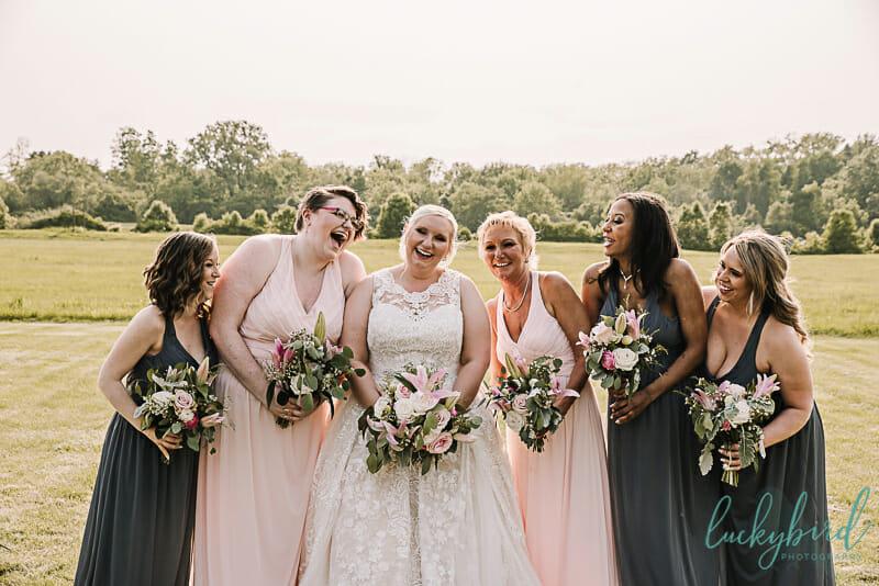 bridesmaids laughing at the pinnacle