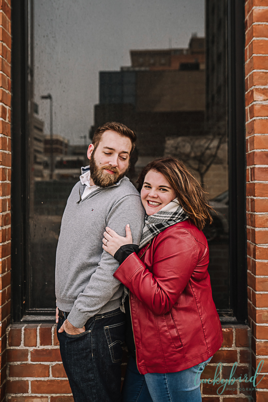 engagement-photos-in-downtown-toledo-with-red-leather-jacket.