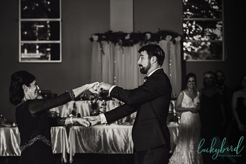 groom and his mom dancing for mother son dance