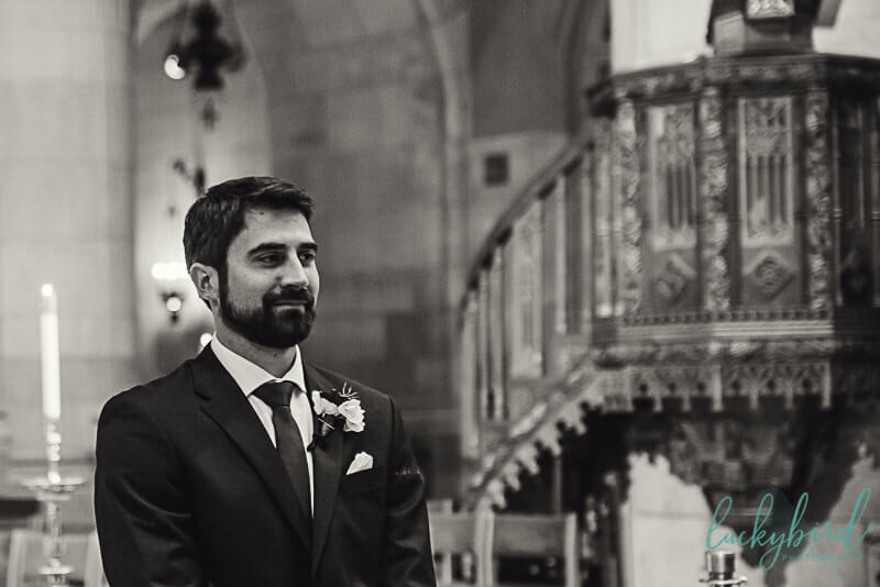groom seeing bride walk down aisle at holy rosary cathedral