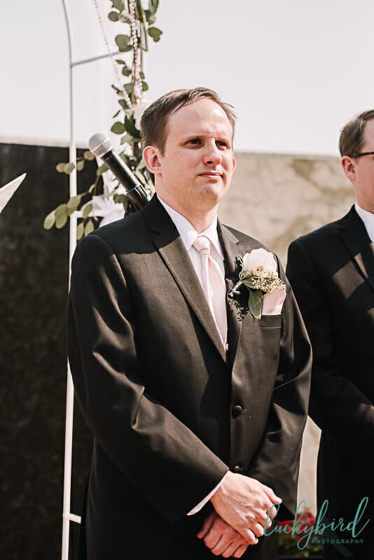 groom seeing bride walk down the aisle at the pinnacle