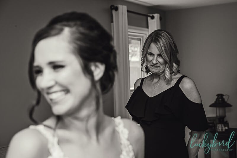 mom and daughter getting ready for wedding ceremony