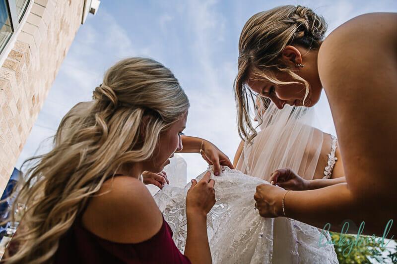sisters bustling wedding dress