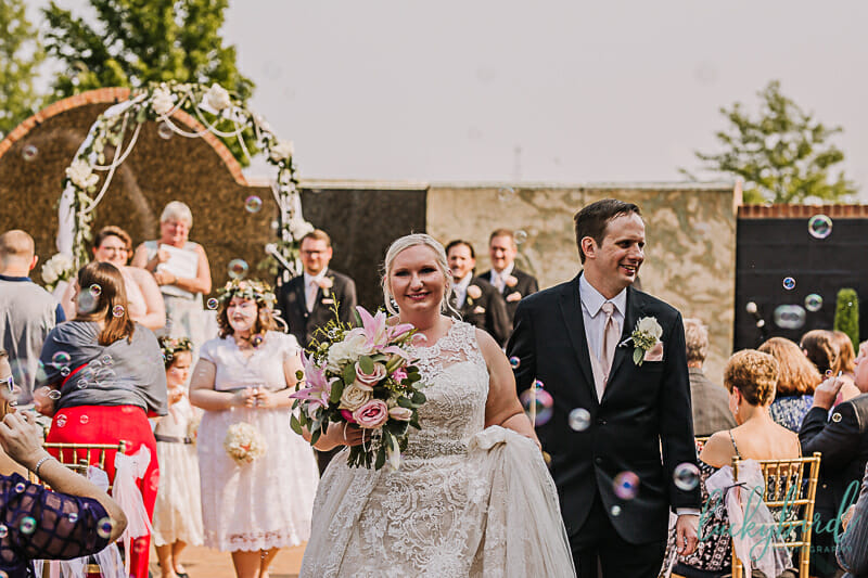 walking down the aisle at a pinnacle maumee ceremony