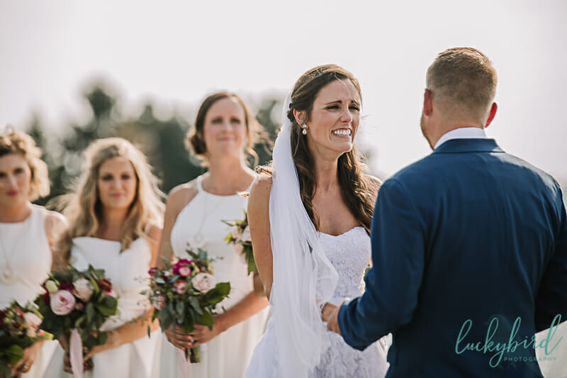 bride crying during grooms vows at maumee bay