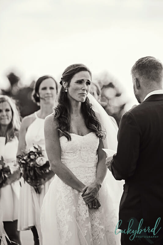 bride crying during vows at toledo beach wedding
