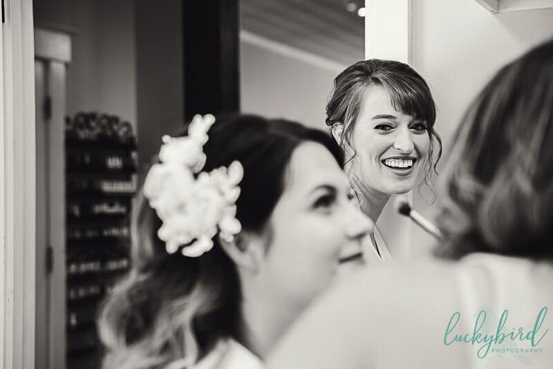 bridesmaid seeing bride getting makeup done