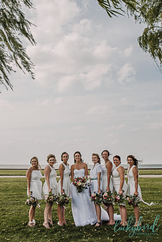 bridesmaids in white dresses at maumee bay