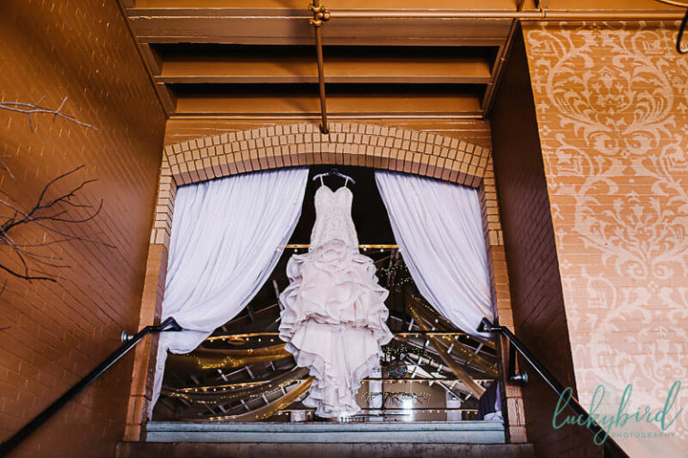 wedding dress hanging at the armory