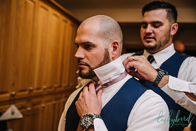 groom getting ready at stone ridge bg