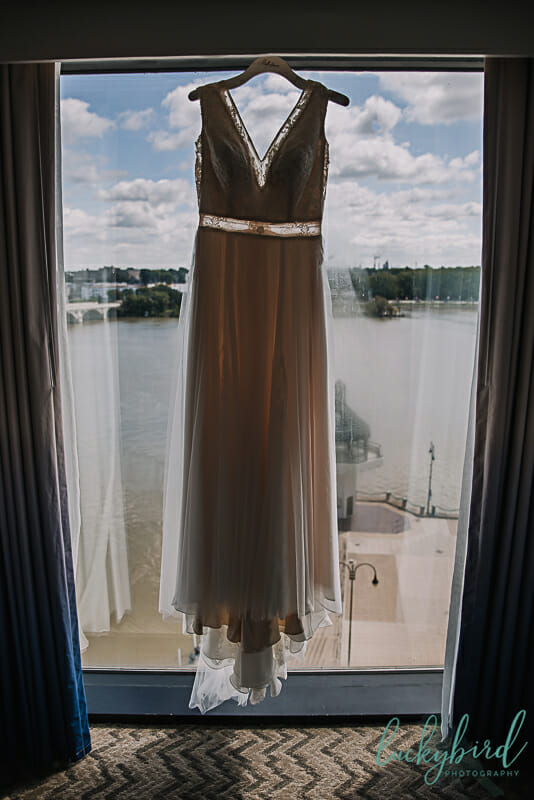 belle amour wedding gown hanging at the renaissance toledo