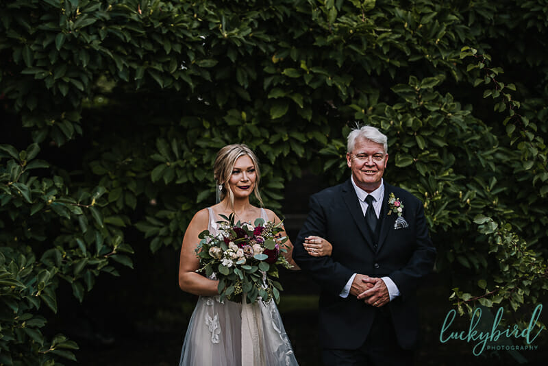 bride and dad walking down the aisle at collingwood arts center outdoor ceremony