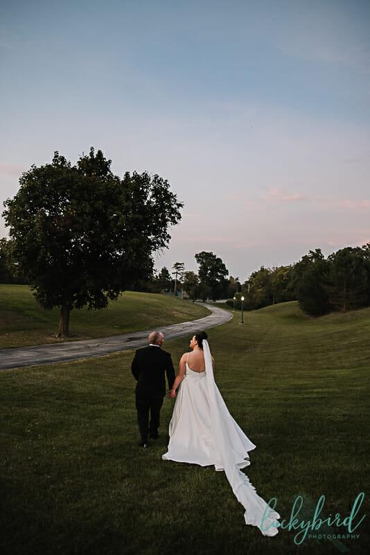 bride and groom at nazareth hall sunset