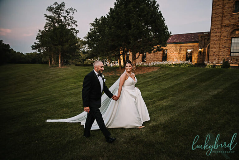 bride and groom walking at nazareth hall