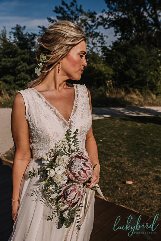 bride holding bouquet elle flora