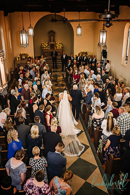 bride walking down the aisle at nazareth hall chapel