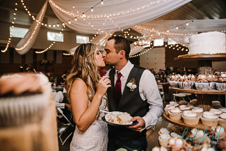 cake cutting kiss photo at the stables wedding