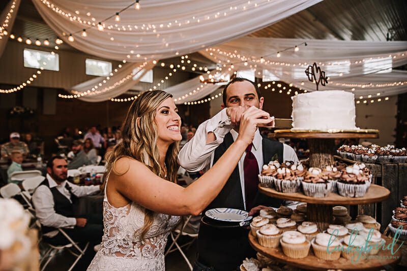 cake cutting wedding photo at the stables