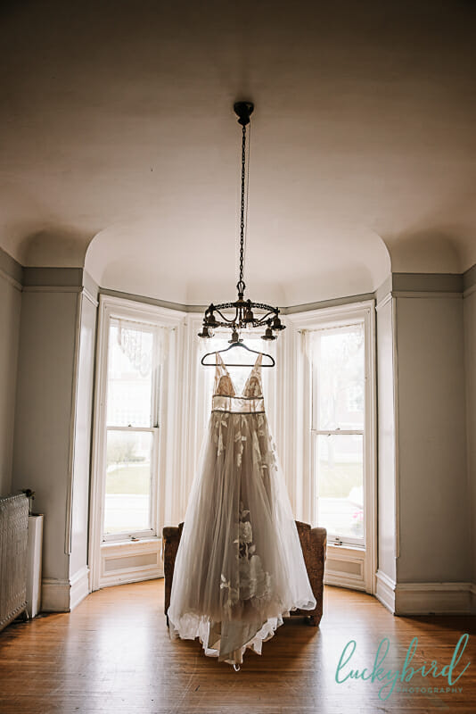 collingwood arts center wedding dress hanging