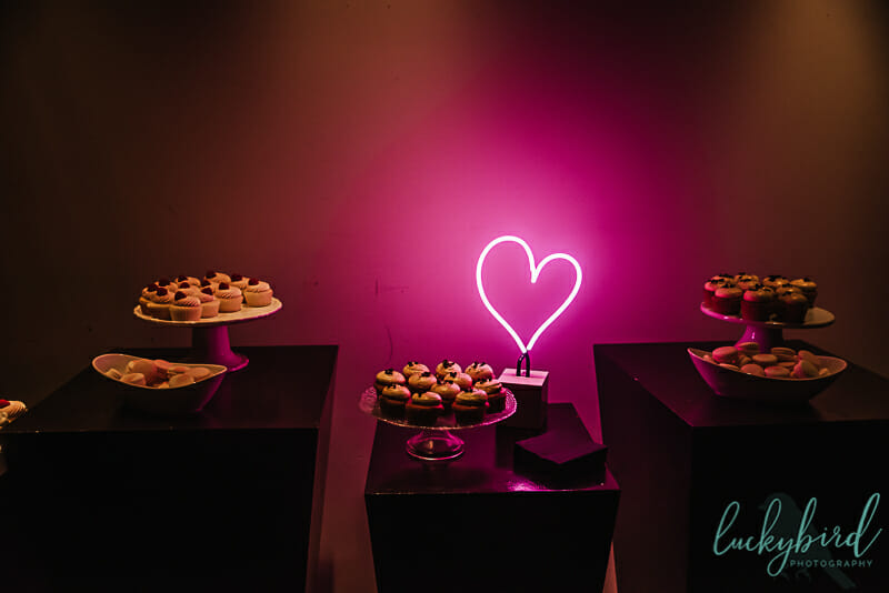 dessert table with neon lights at registry bistro